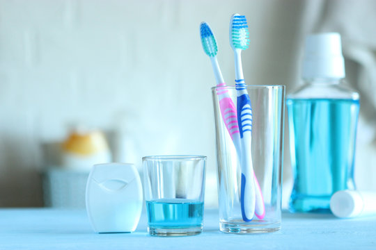 Toothbrushes and oral cleaners on the table.