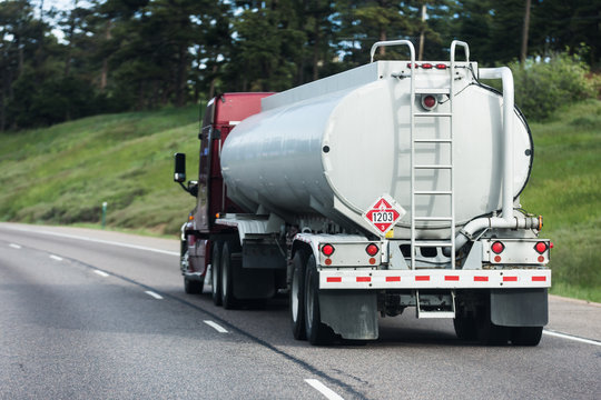 Large tanker truck hauling on highway