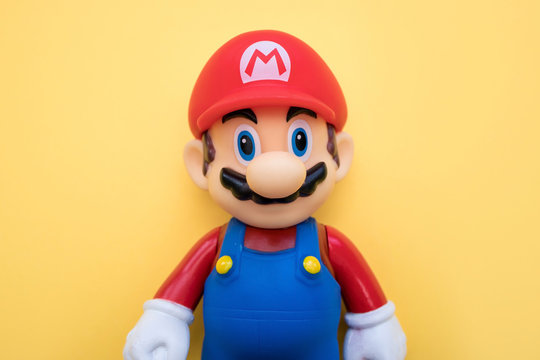 LONDON - JULY 31, 2019: Super Mario Nintendo video game character on yellow background