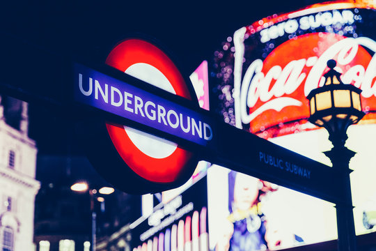 LONDON - NOVEMBER 09, 2017: Underground tube sign at Piccadilly Circus at night in West End London.