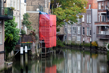 Scaffolding for renovation of a canal house in Dordrecht in the Netherlands