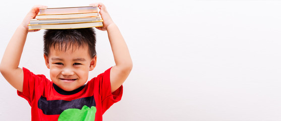 Back to school, Asian student boy kid stack book balanced on head