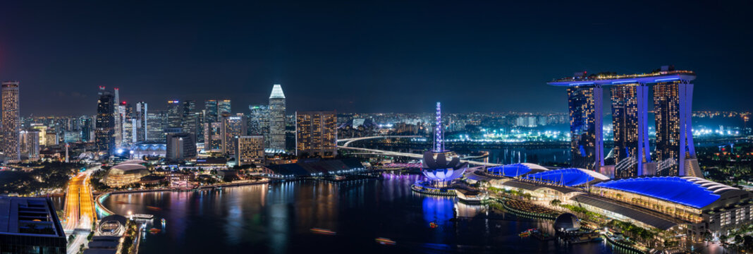 Wide panorama of Singapore skyscrapers at night