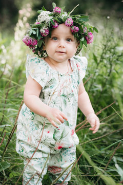 Portrait of cute little girl with flower wreath on her head
