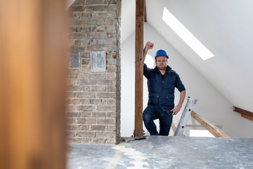 Architect standing on construction site of a loft conversion