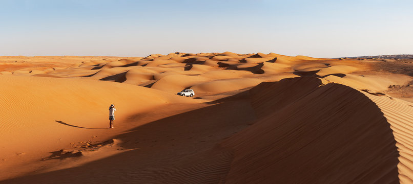 Man with off-road vehicle, taking pictures in the desert, Wahiba Sands, Oman