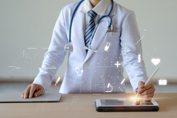 Woman doctor holding digital pencil and touching screen on smart device