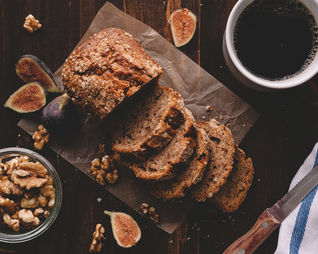 Overhead view of banana bread slices with walnuts