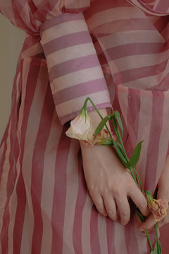 Close up view of woman holding withered white lily