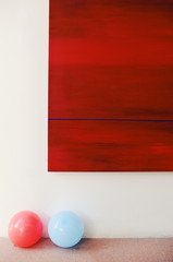 Abstract painting and red and blue balloons