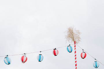 Low angle view of red, white, and blue paper lanterns