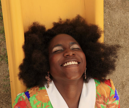 High angle view of smiling woman in colorful blouse