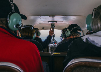 Rear view of people in small airplane