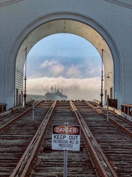 Danger sign at railroad track