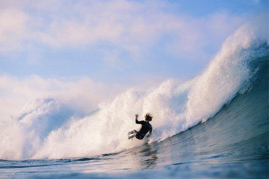 Surfer falling off big waves