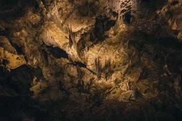 Sunlight falling on rocks in cave