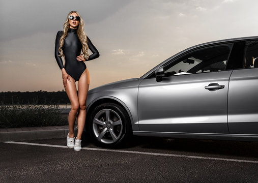 Glamorous sexy blonde in a car. Photos in the city