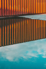 Reflection of cargo container in water