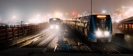 Trains moving on railroad at night