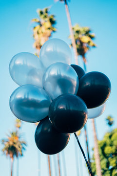 Bunch of balloons against sky