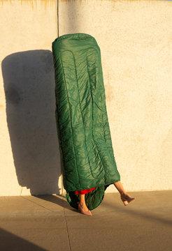 Model in high heels wearing sleeping bag