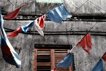 Buntings hanging against old building