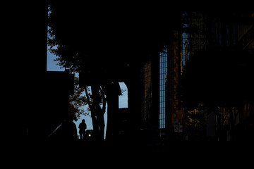 A woman walks up a street in downtown Los Angeles, California