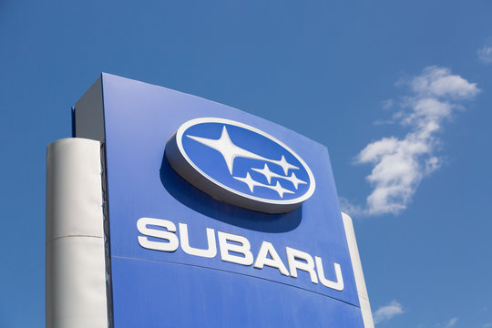 Moscow, Russia - May, 2018: Subaru automobile dealership Sign against blue sky. Subaru is a japanese manufacturer of automobiles