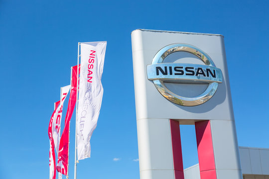 Moscow, Russia - May, 2018: Nissan automobile dealership sign with flags against blue sky. Subaru is a japanese manufacturer of automobiles and commercial vehicles