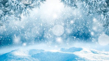 Table background of free space and winter landscape with snowflakes.