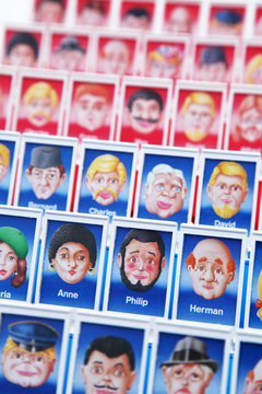 editorial image of all kinds of men and women in the 'Guess Who?' board game - circa 2016 - Louvain, Belgium