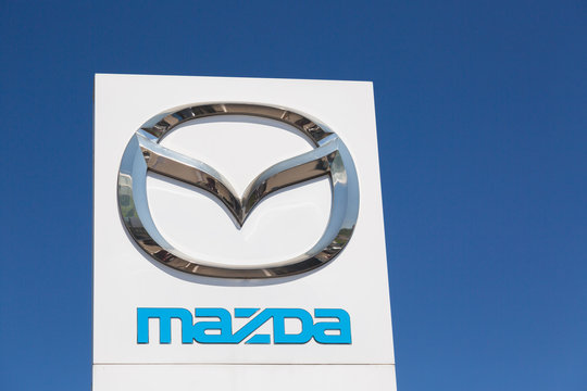 Moscow, Russia - May, 2018: Mazda automobile dealership Sign against blue sky. Mazda is a japanese manufacturer of automobiles and commercial vehicles.