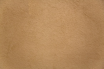 gray beige porous granular wall with shadows. rough surface texture