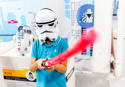 ULTRA MALL, UFA, RUSSIA, 21 AUGUST, 2017: A boy in a mask and suit of a stormtrooper with a laser sword depicts the hero of the movie Star Wars