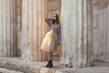 Teen girl in brown tulle skirt and autumn sweater