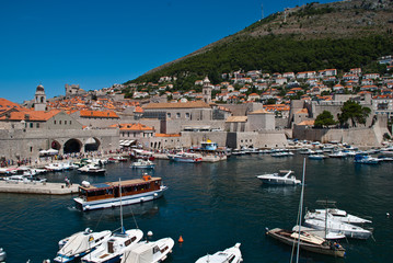 Dubrovnik, Croatia: View of the Old Port. Dubrovnik is a Croatian city on the Adriatic Sea. It is one of the most prominent tourist destinations in the Mediterranean Sea