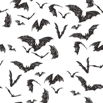 Vector seamless pattern with flock of bats isolated on white. Hand drawn texture with symbol of All Saints Day. Halloween background