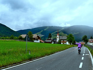 Italian Alps-view on the cyclist in Valdaora