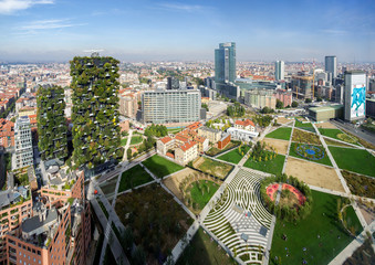 Porta Nuova District, Milan, Italy, October 5, 2019 - Panoramic view on Park Biblioteca degli Alberi (Library of Trees) by architect Petra Blaisse, on the left is the pair of towers Bosco Verticale