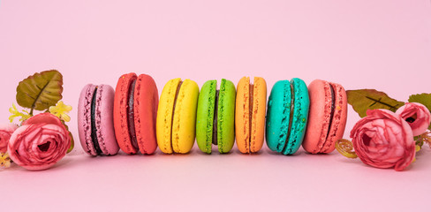 Türaufkleber Macarons Multicolored macaroons on pink background. Sweet and colourful french macaroons