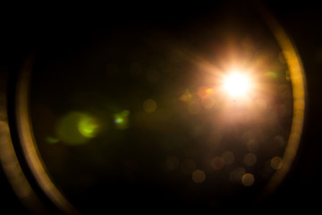 abstract lens flare red light over black background