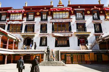 Tibetan Bhuddists wander the courtyard in Drepung Monastery in Lhasa, Tibet.