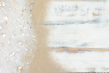 Horizontal vintage old rough grunge white tone wood plank texture  with sand and sea shell background flat lay.