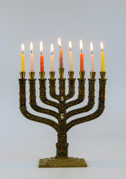 A symbolic candle lighting for the Jewish holiday of Hanukkah Menorah with lit candles in celebration of Chanukah.