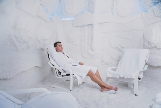 A young man is resting in the salt room, Spa treatments for men with respiratory disorders, inhalation Procedure in the Olean grotto