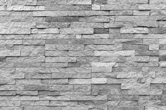 White natural facade stone decoration quartzite background texture. modern granite stone wall.