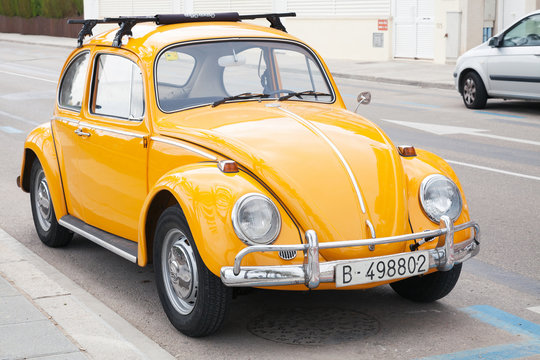 CALAFEL, SPAIN - AUGUST 20, 2014: Yellow Kafer stands parked on the roadside