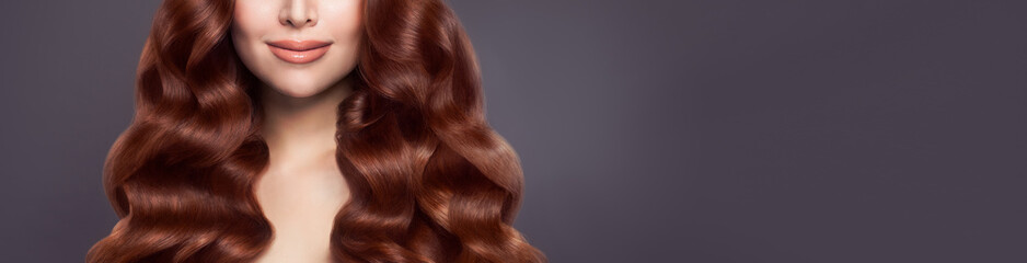 Beautiful woman hair. Long healthy brown curly hair on banner background