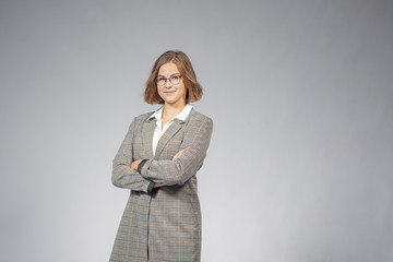 portrait of a young girl in business outfit