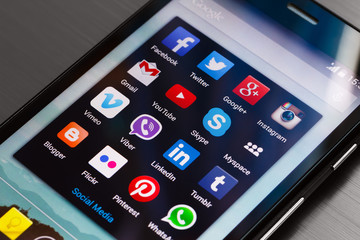 Different popular social media icons in a group folder on android smartphone home screen